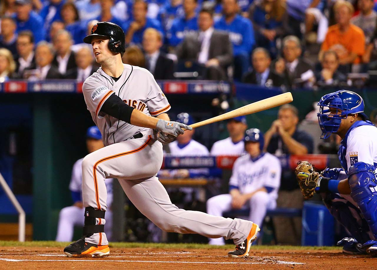 Buster Posey delivers a hit in the Giants' three-run first inning.