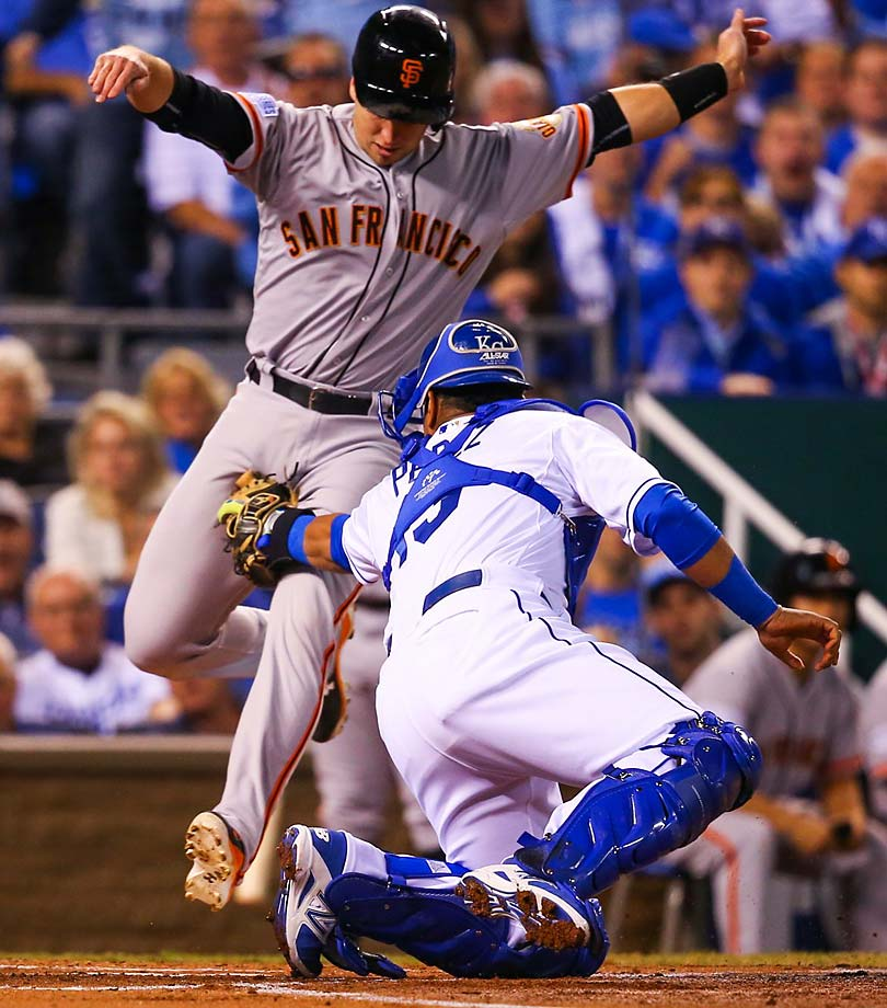 Salvador Perez had plenty of time on the relay throw from Omar Infante to easily tag out Buster Posey.