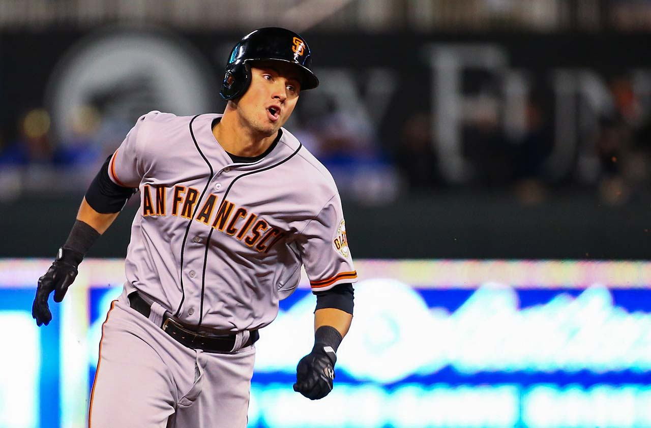 Joe Panik heads to third on a RBI triple in the seventh inning.