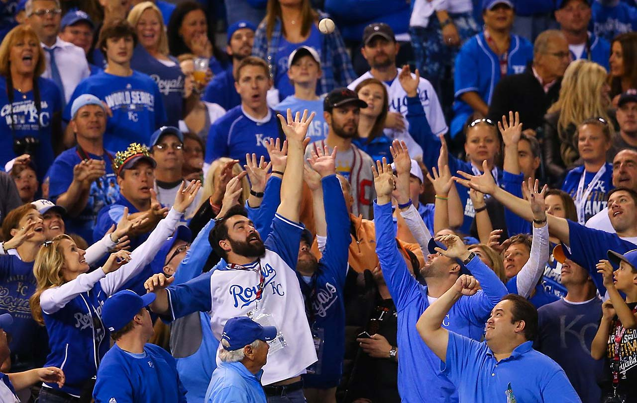 Kansas City fans jostle for a foul ball in the first World Series game in that city since 1985.
