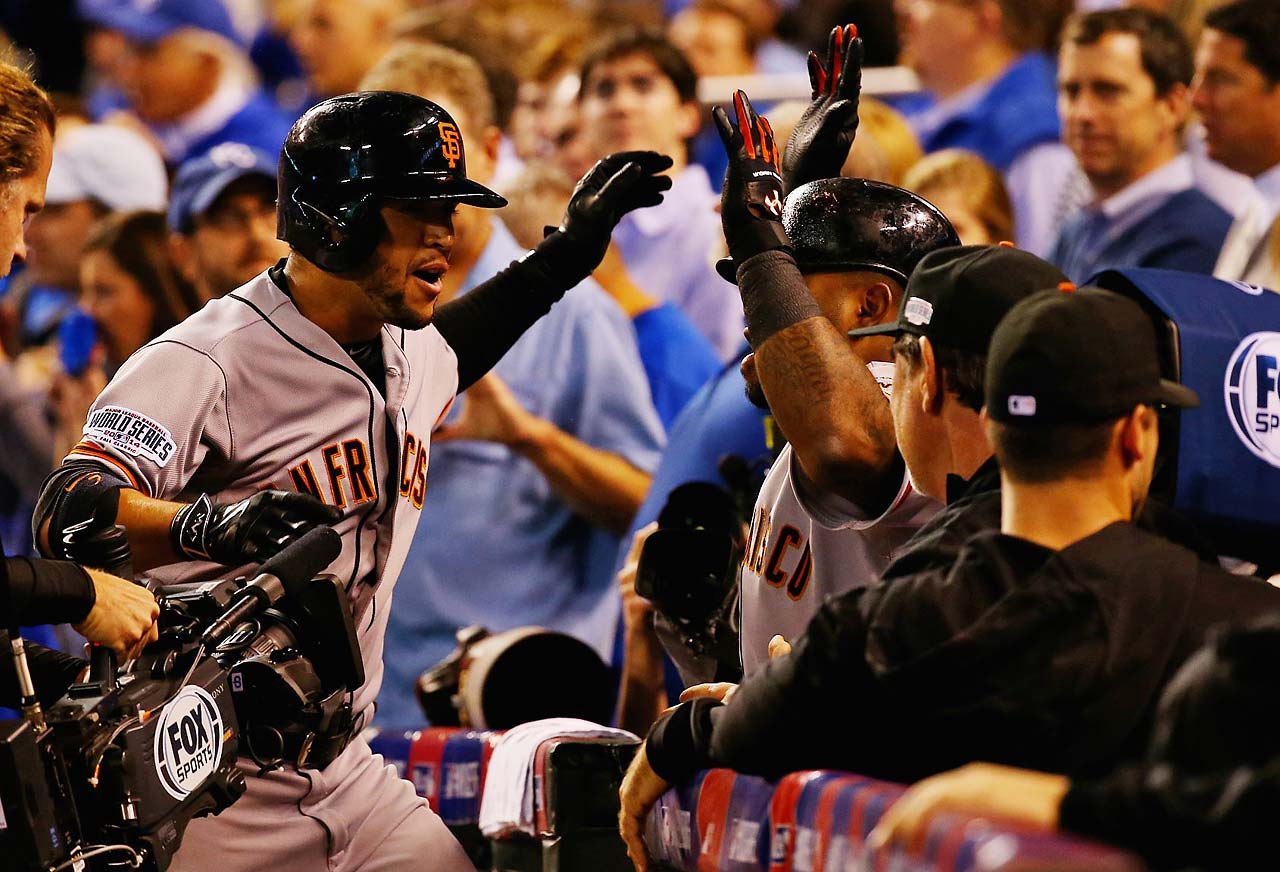 Gregor Blanco is congratulated by teammates after giving the Giants a 1-0 lead.