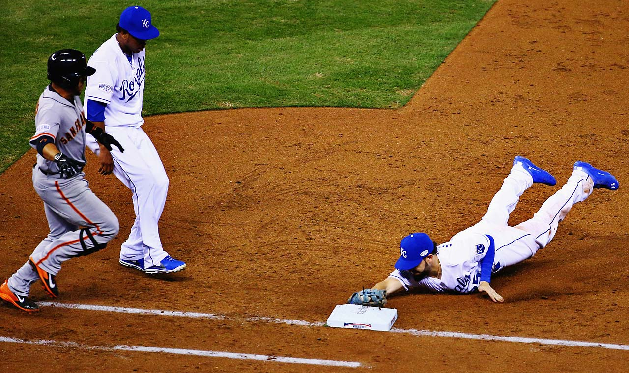 Eric Hosmer dives to first to get Gregor Blanco out in the third inning.