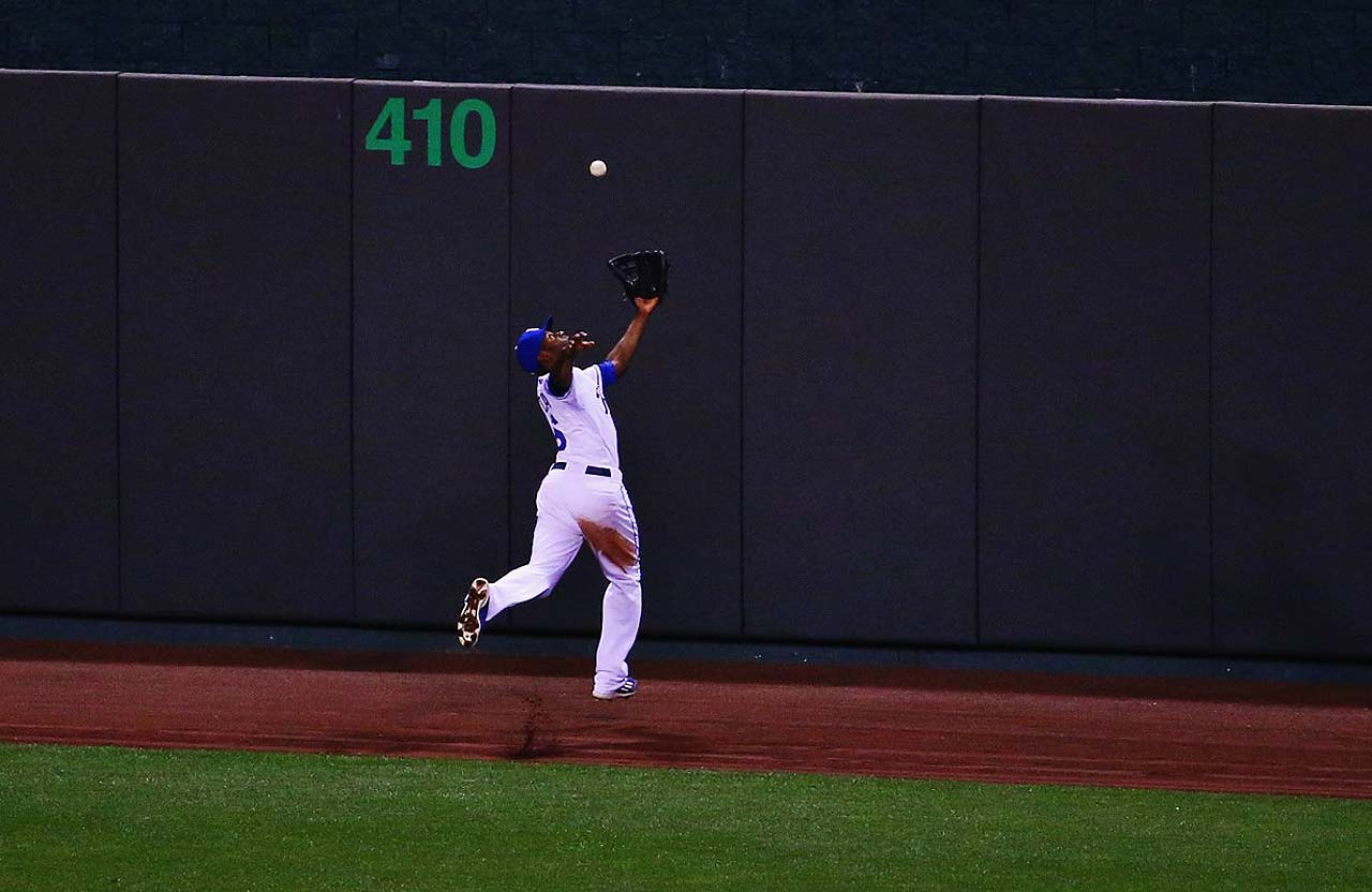Lorenzo Cain attempts to reel in a ball off the bat of Pablo Sandoval.