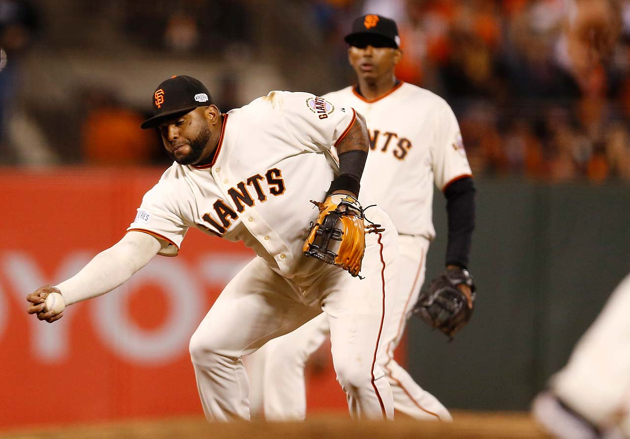Pablo Sandoval barehands a balll before throwing to first to record an out.