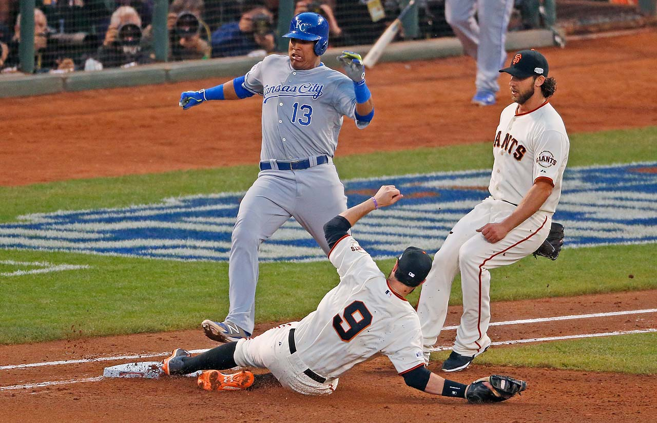 First baseman Brandon Belt made a slide back to the bag to get Salvador Perez out in the top of the fourth.