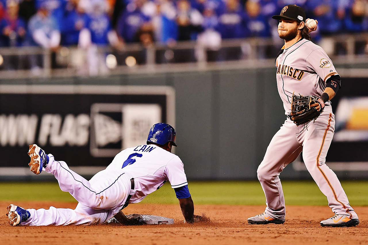 Lorenzo Cain tries to break up a double-play throw by Brandon Crawford.