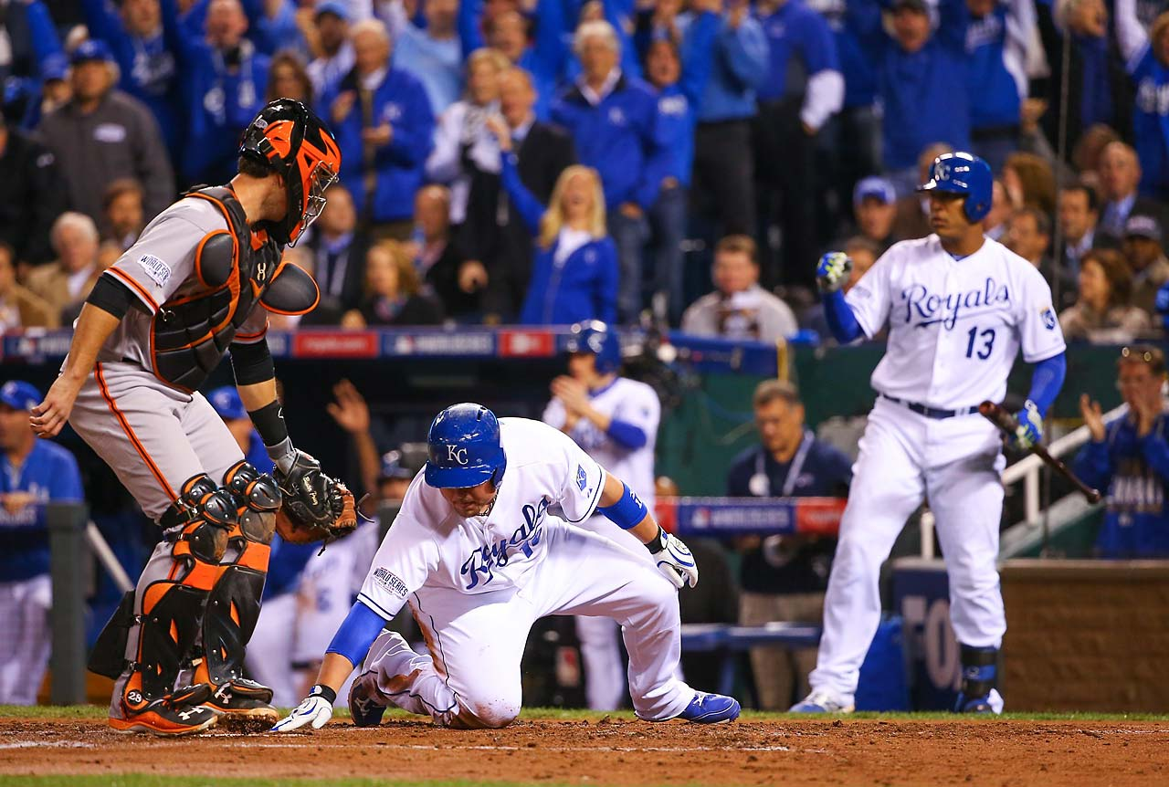 Even though he was safe on the slide, Butler made doubly sure by touching home plate with his hand.