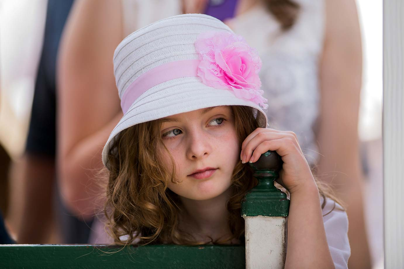 A young fan looks on from the grandstand at Churchill Downs.