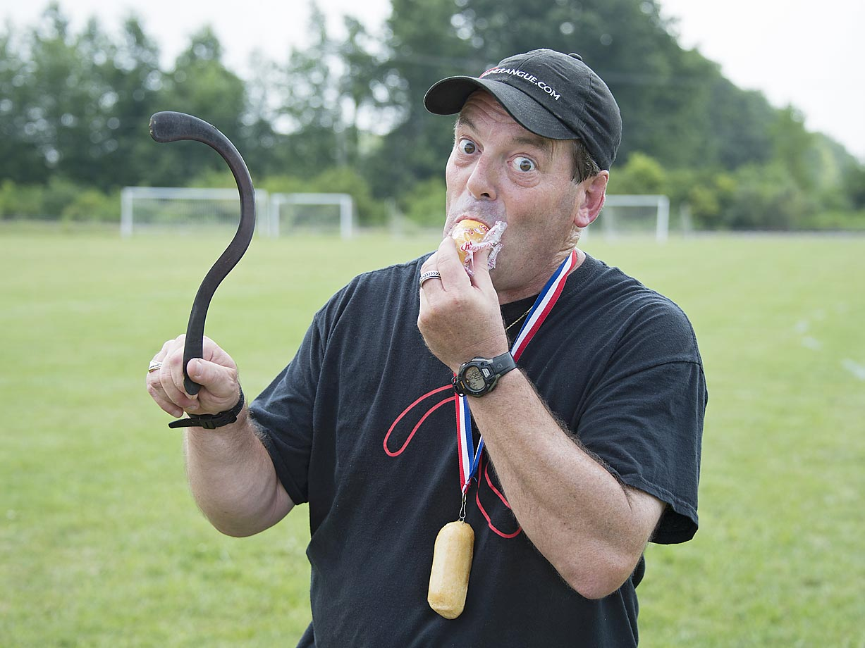 "Gary Broadbent wears the ""Twinkie Amulet"" -- eating the spongy goodness as the traditional reward for throwing over 100 meters with a successful return."