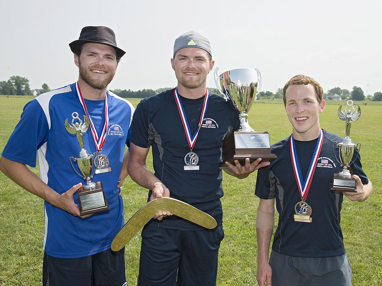 Dan Bower (middle) displays his championship trophy along with second-place finisher Richard Bower (left) and Logan Broadbent, who took third.