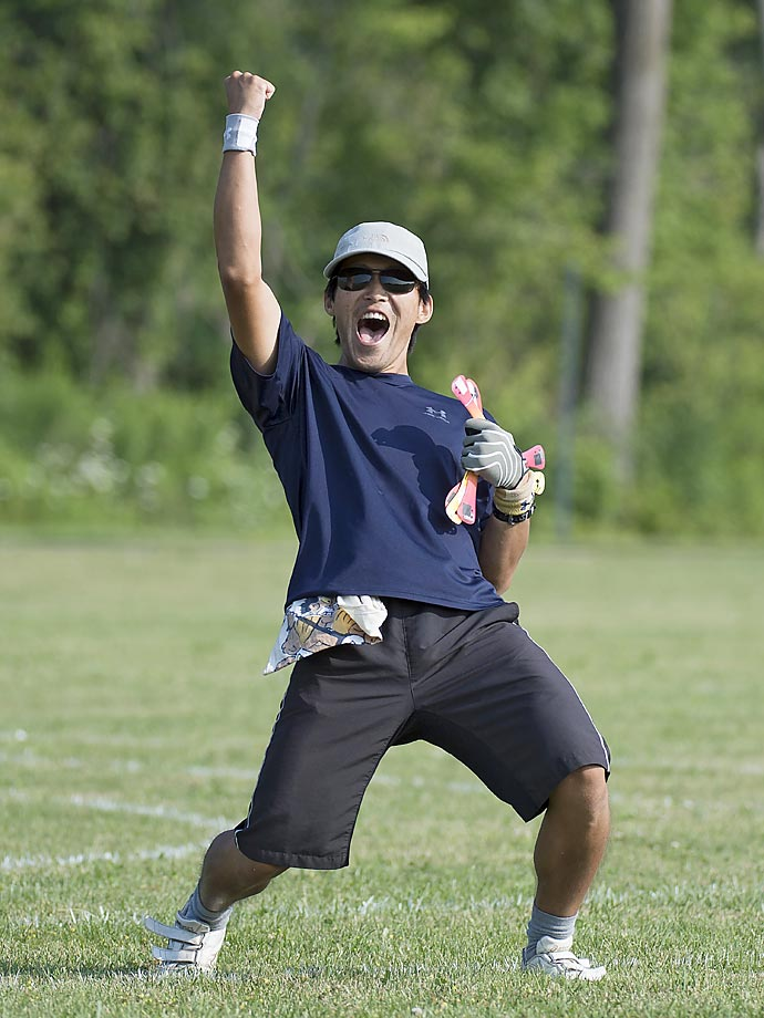 Takeshi Honda of Japan celebrates his first-place victory in the fast-catch event.