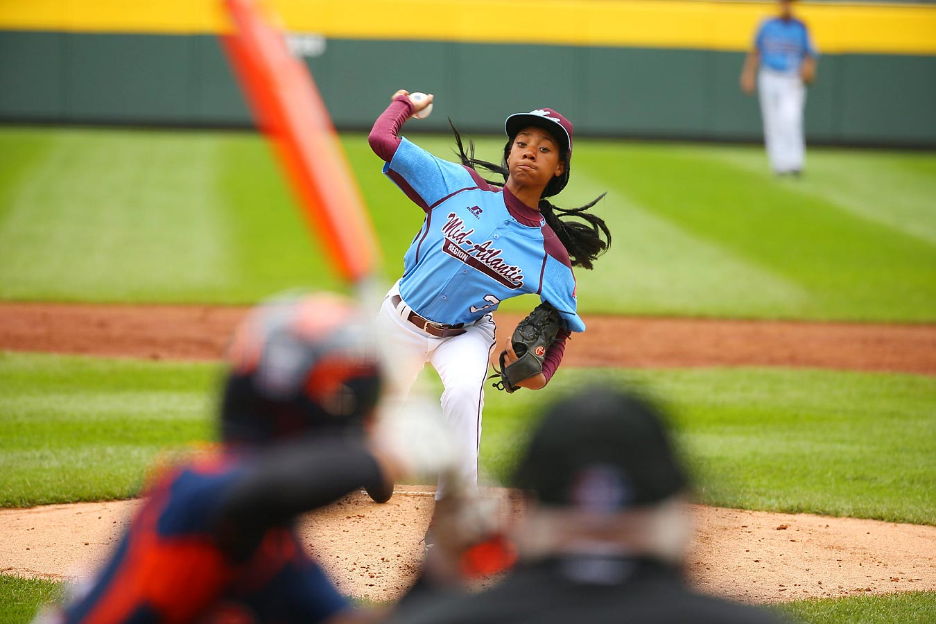Thirteen-year-old sensation Mo'ne Davis, who plays for Philadelphia's Taney Dragons, has captured the nation's attention with her performance at the Little League World Series. SI made the 5-foot-4 inch, 111-pound eighth grader the cover subject of this week's issue and sent a photographer to South Williamsport to follow her and the team. Here are the best shots from that assignment.
