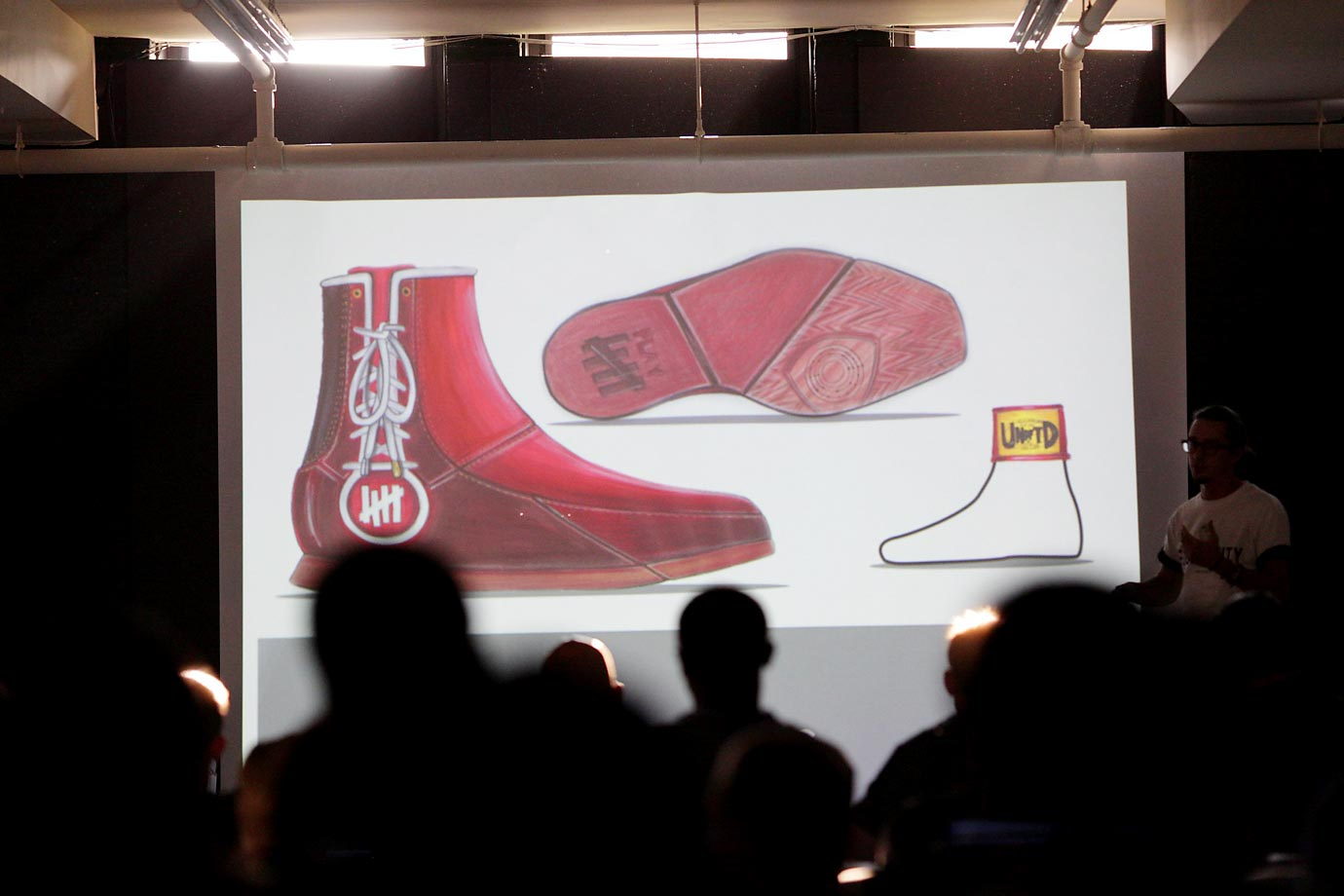 Inspired by Mike Tyson, Andrew Parks designed a boxing sneaker that featured patent red leather (like Everest gloves), a terrycloth interior (because Tyson walked out in the ring with a towel draped over his shoulders, not a silky robe) and one gold lace tip (for Tyson's gold teeth).