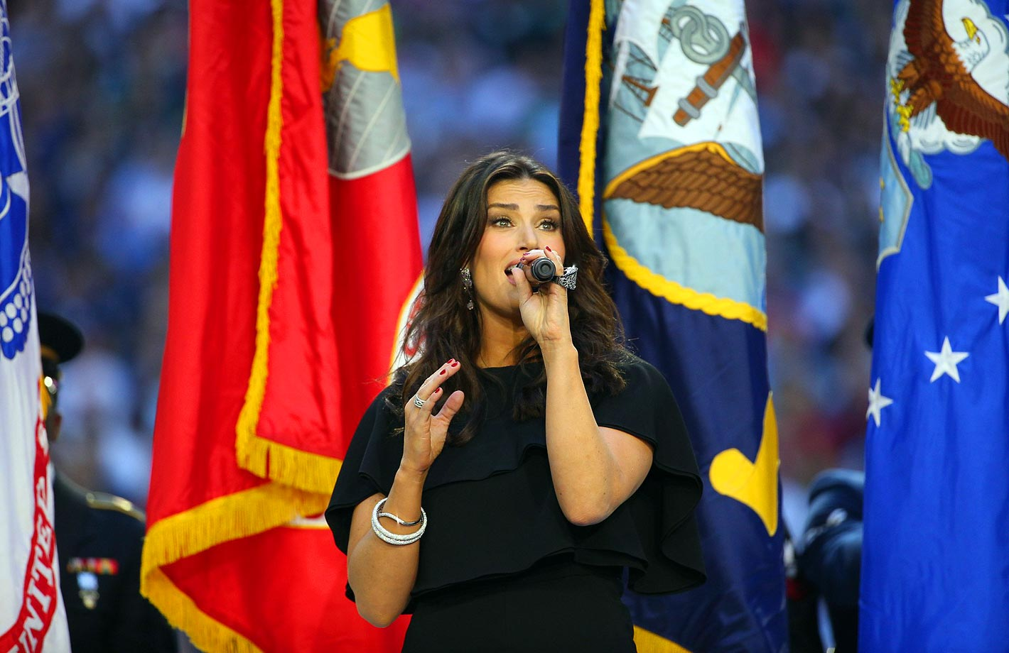 Singer Idina Menzel sings the national anthem prior to Super Bowl XLIX.
