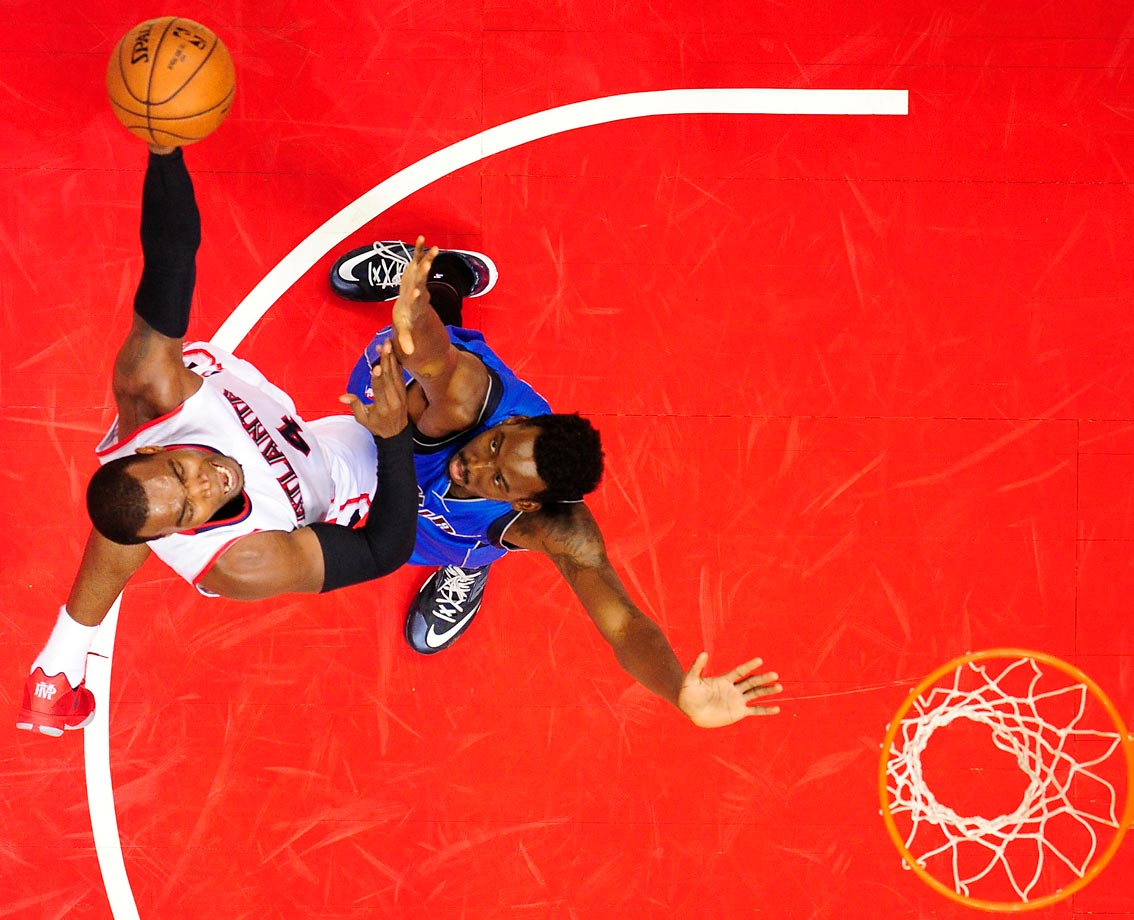 Paul Millsap (4) of the Atlanta Hawks goes up for a layup during a game against the Dallas Mavericks.