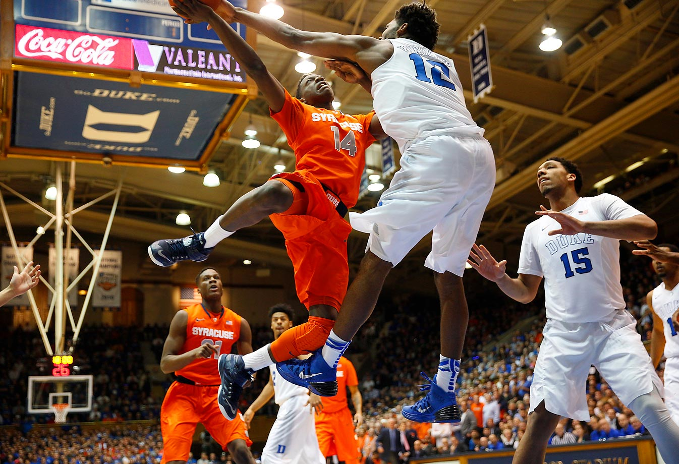 Kaleb Joseph (14) works to shoot against forward Justise Winslow (12) during a game between the Syracuse Orange and Duke Blue Devils.