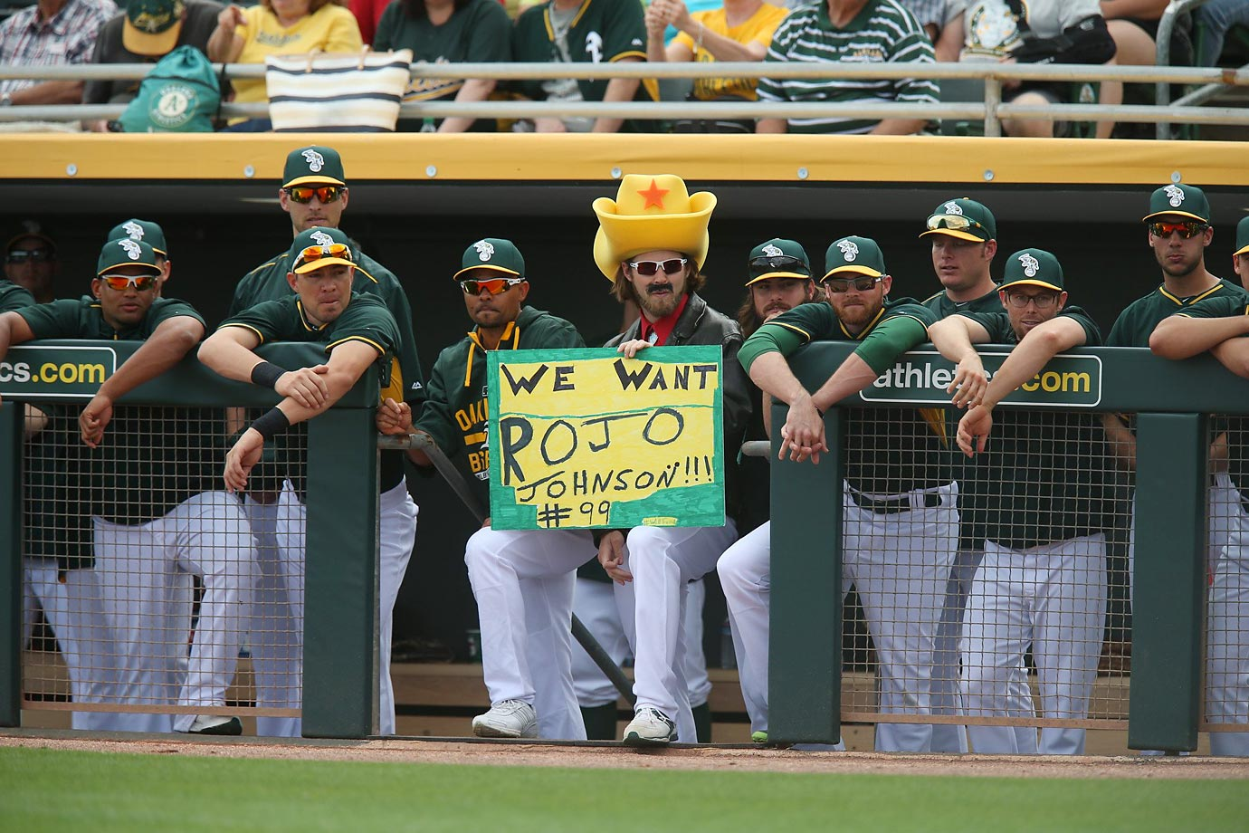 Josh Reddick cheers on Will Ferrell acting as Rojo Johnson on the mound.