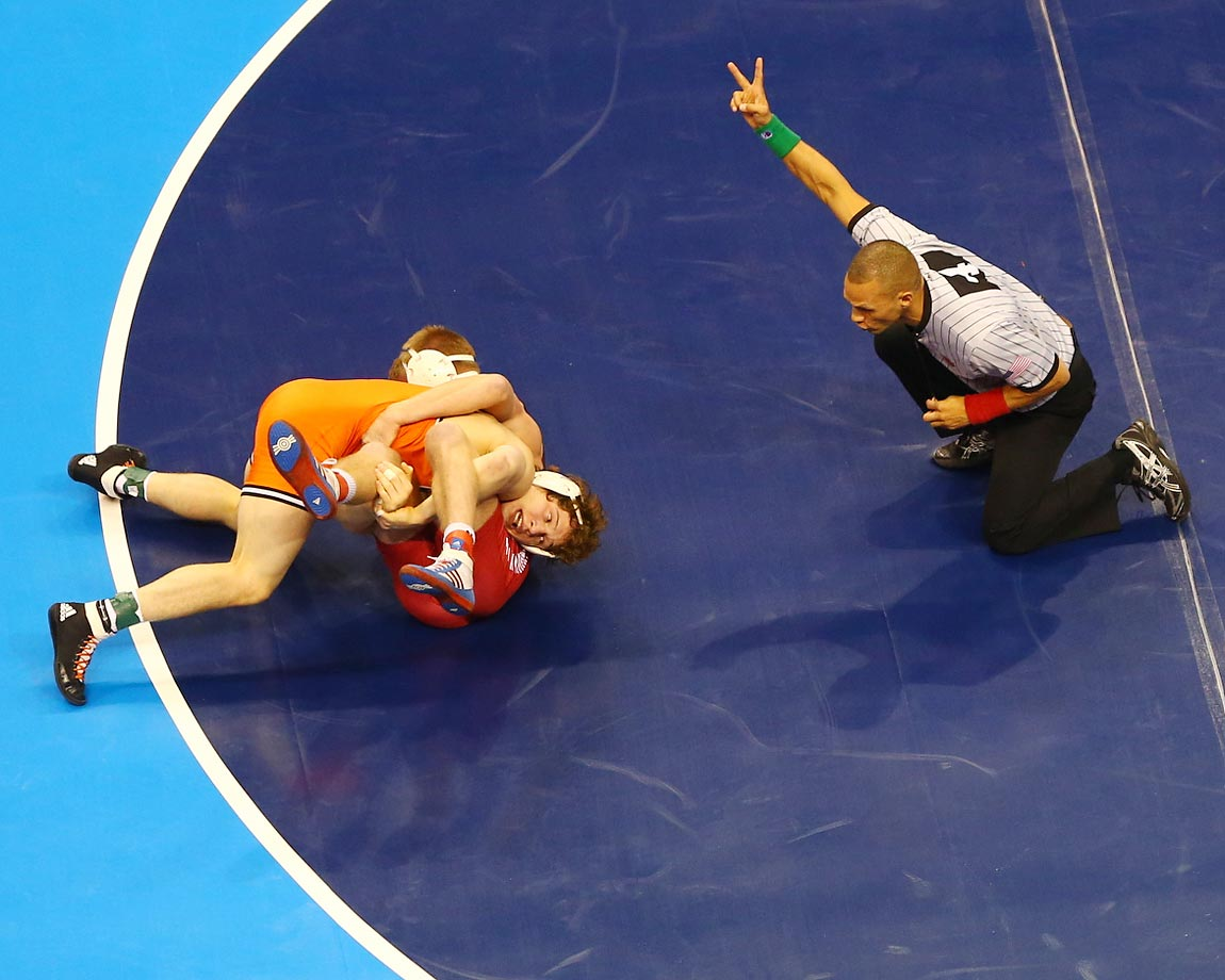 An aerial view of Oklahoma State and Indiana wrestlers on the mat at the NCAA Division I Wrestling Championships in St. Louis.