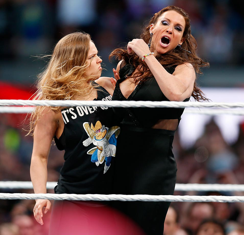 Mixed martial artist and part-time pro wrestler Ronda Rousey collars Stephanie McMahon during WrestleMania 31.