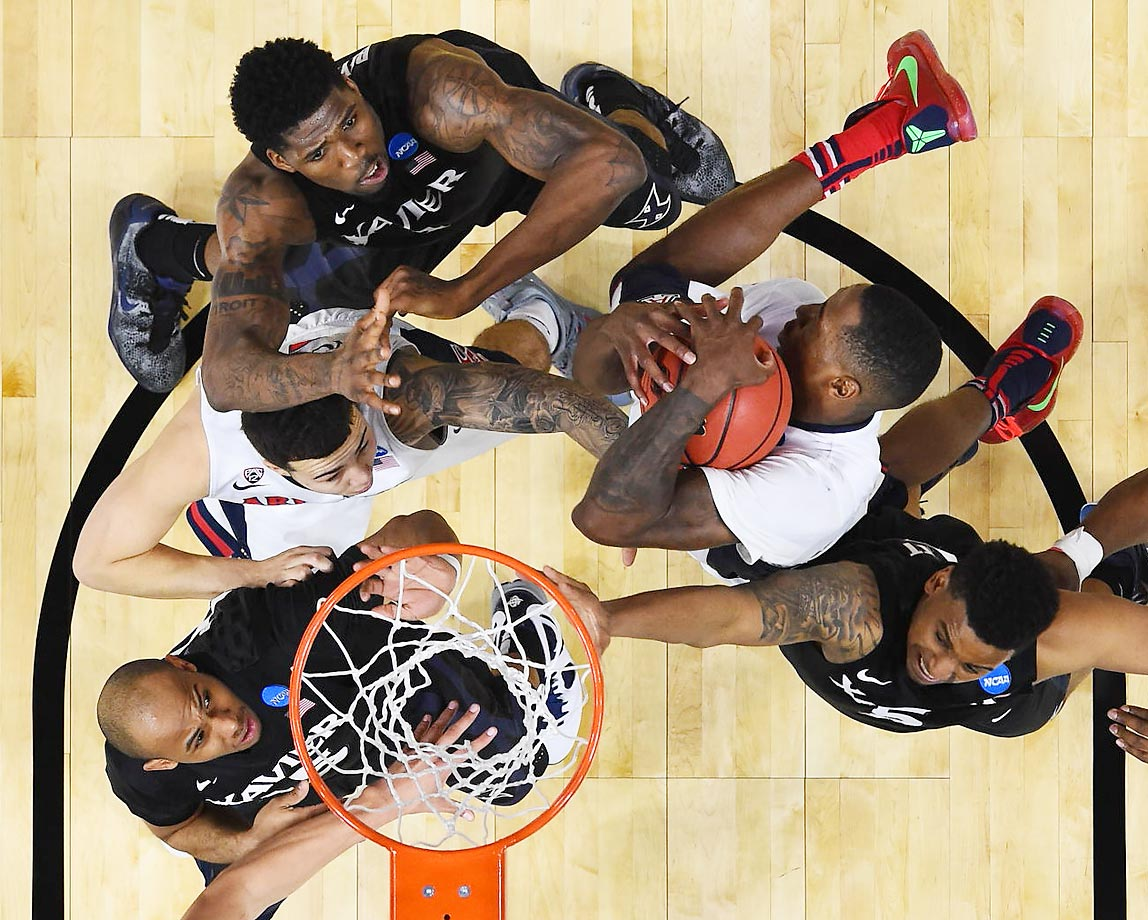 Arizona's Rondae Hollis-Jefferson pulls down a highly contested rebound during the second-seeded Wildcats' 68-60 dispatching of sixth-seeded Xavier in the Sweet 16 in Los Angeles.