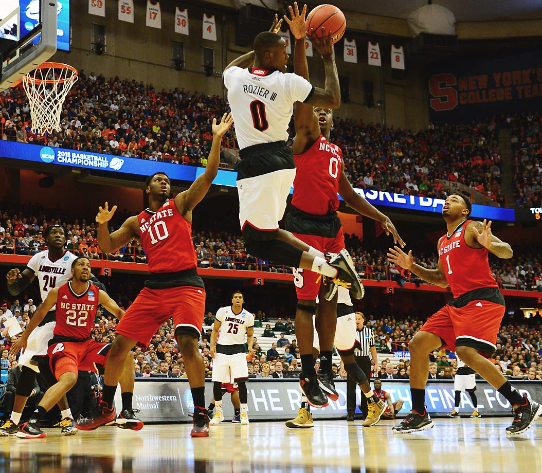 Louisville guard Terry Rozier looks to pass as North Carolina State defenders converge on him during the Cardinals' 74-65 Sweet 16 victory in Syracuse. Louisville was bounced by Michigan State in the Elite 8 two days later.