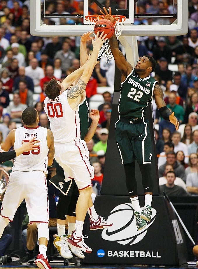 Michigan State forward Branden Dawson rejects Oklahoma's Ryan Spangler during a Sweet 16 game in Syracuse. Dawson and the Spartans defeated the Sooners and the Louisville Cardinals to advance to the Final Four in Indianapolis.