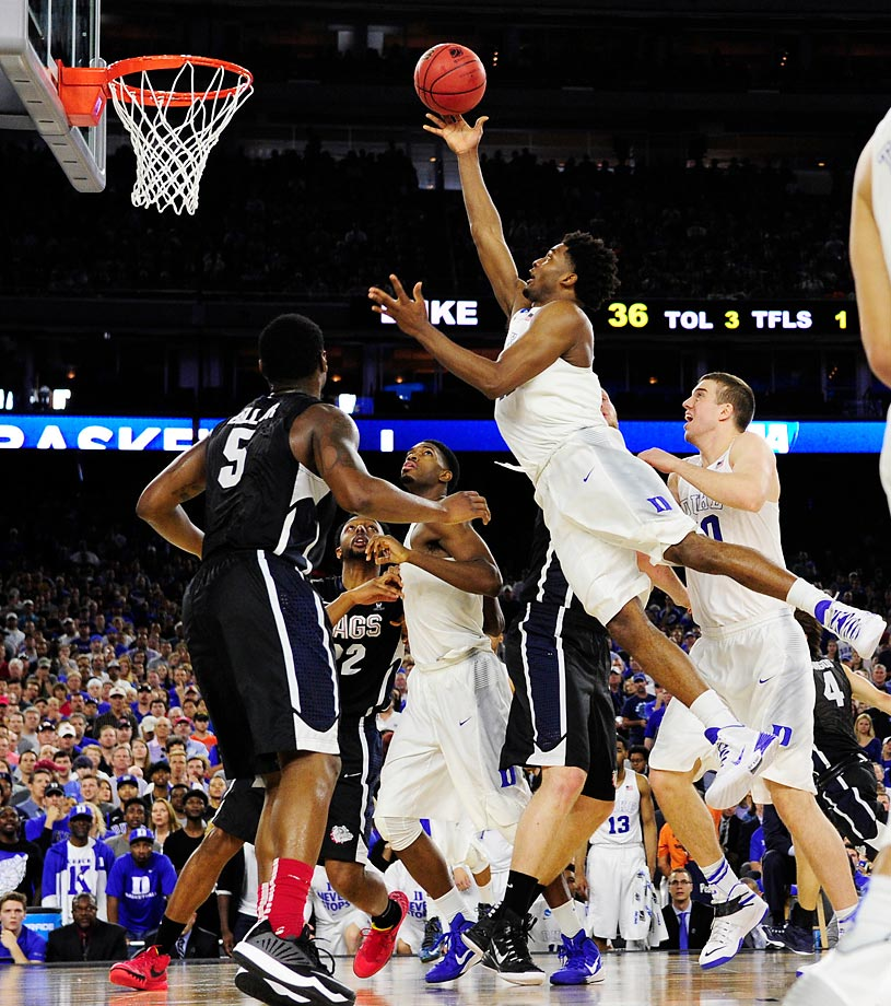 Duke's Justise Winslow floats toward the basket with little opposition from the Gonzaga defense. Behind Winslow's 16 points and five rebounds, the top-seeded Blue Devils cruised 66-52 to reach the Final Four.