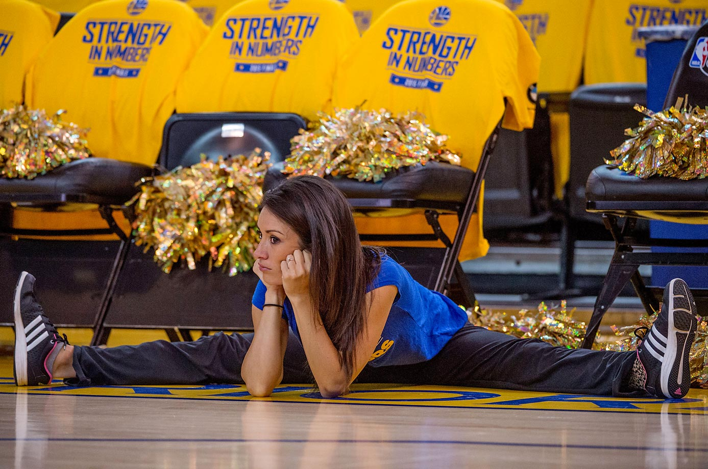 A Golden State Warriors dancer stretches before Game 2 of the NBA Finals on June 7.