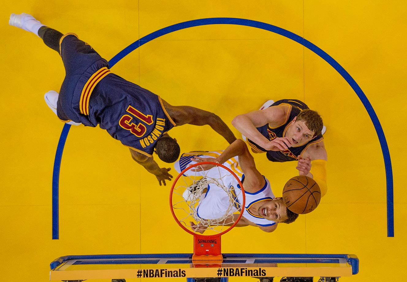 Golden State Warriors guard Stephen Curry and Cleveland Cavaliers center Timofey Mozgov fight for a rebound during Game 2 of the NBA Finals on June 7.