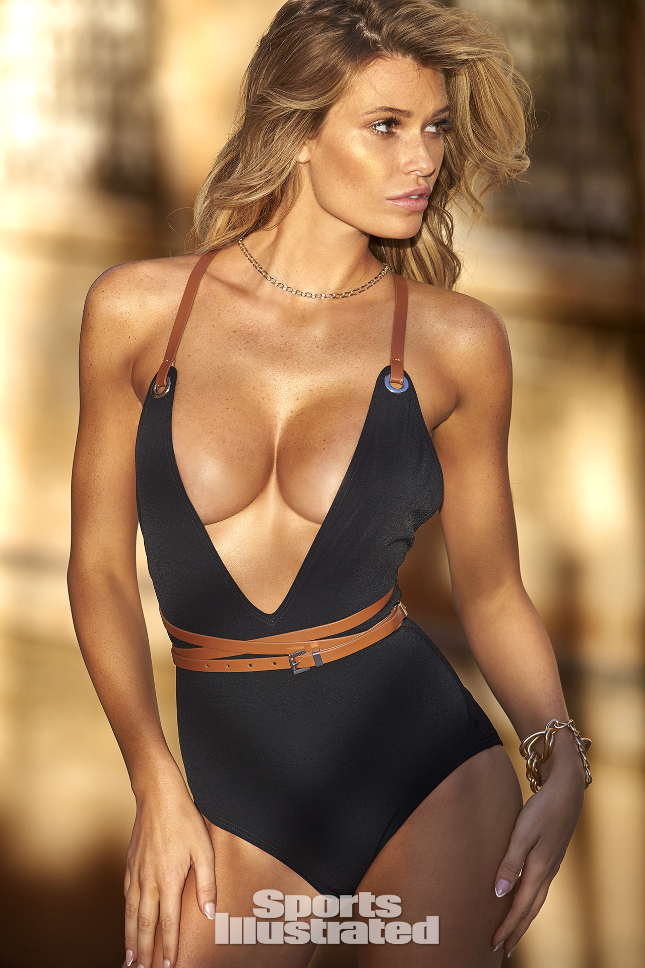Samantha Hoopes was photographed by Ben Watts in Malta. Swimsuit by Michael Kors Collection.