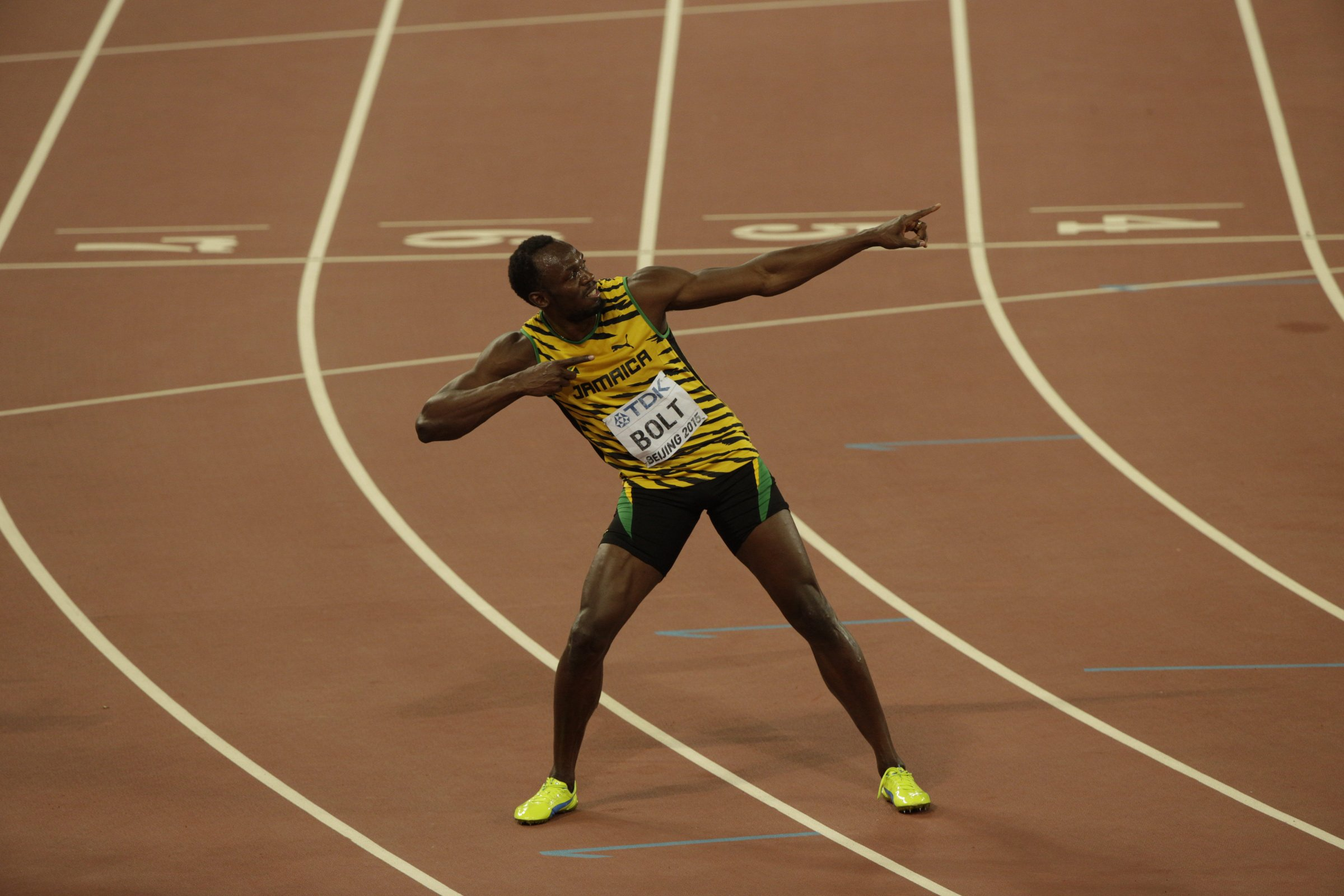 "Usain Bolt (JAM) hits his ""To Di World"" pose after running 9.79 for 100-meters and winning his third gold medal at the distance."