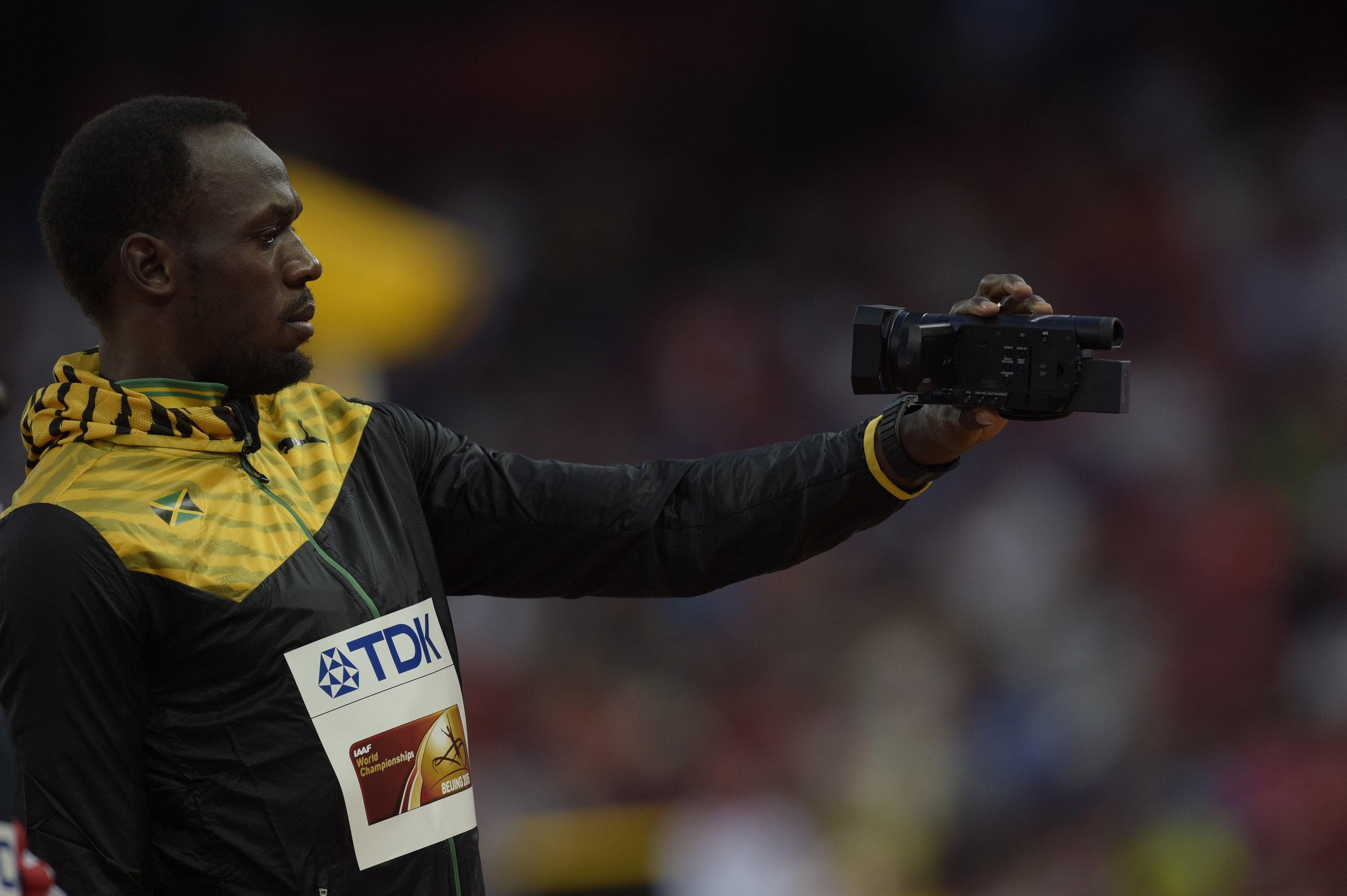 Usain Bolt (JAM) gold videotaping on the podium before the men's 100-meter dash award ceremony.
