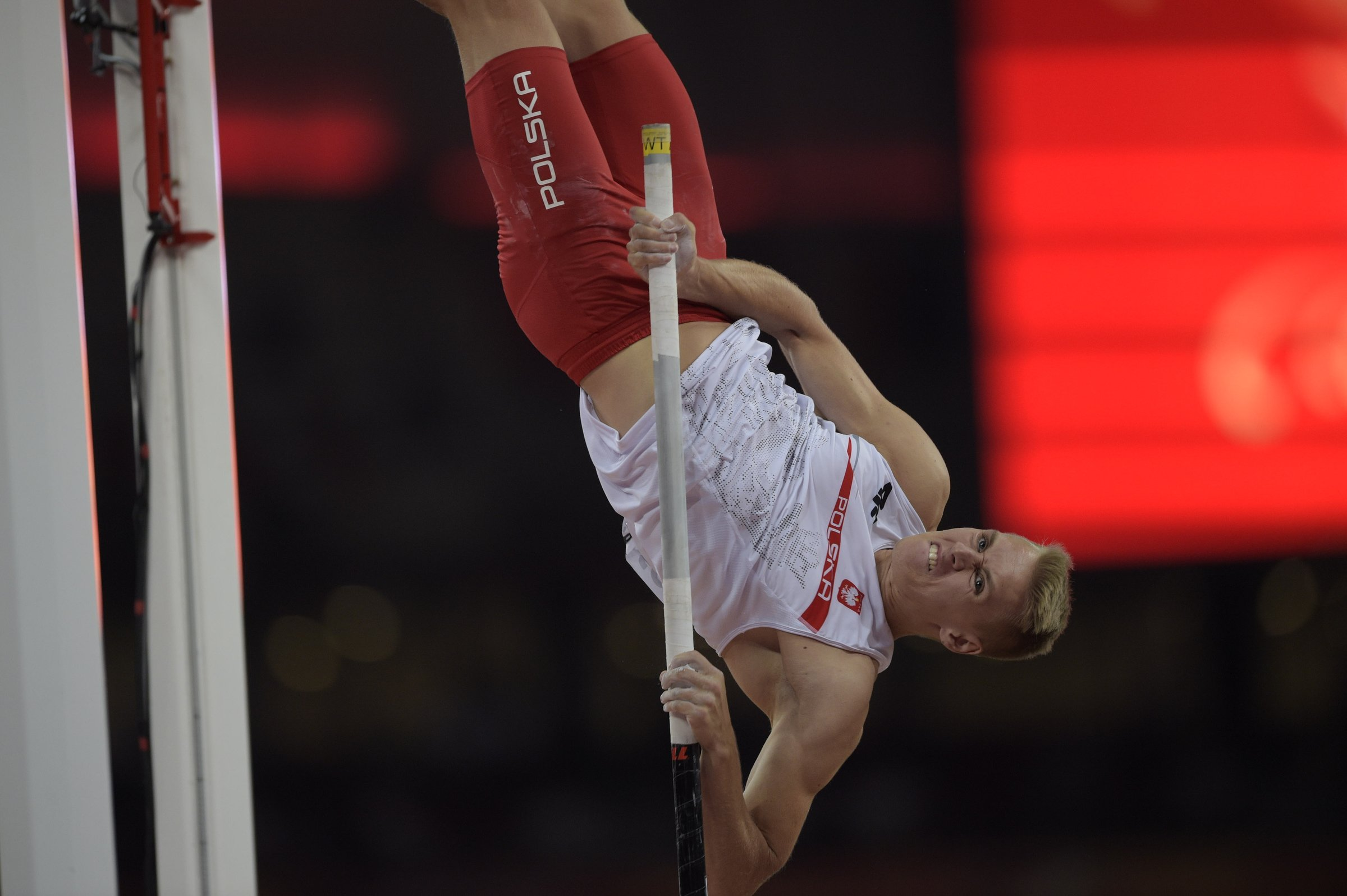 Robert Sobera (POL) clears the 5.50-meter height in the men's pole vault competition.