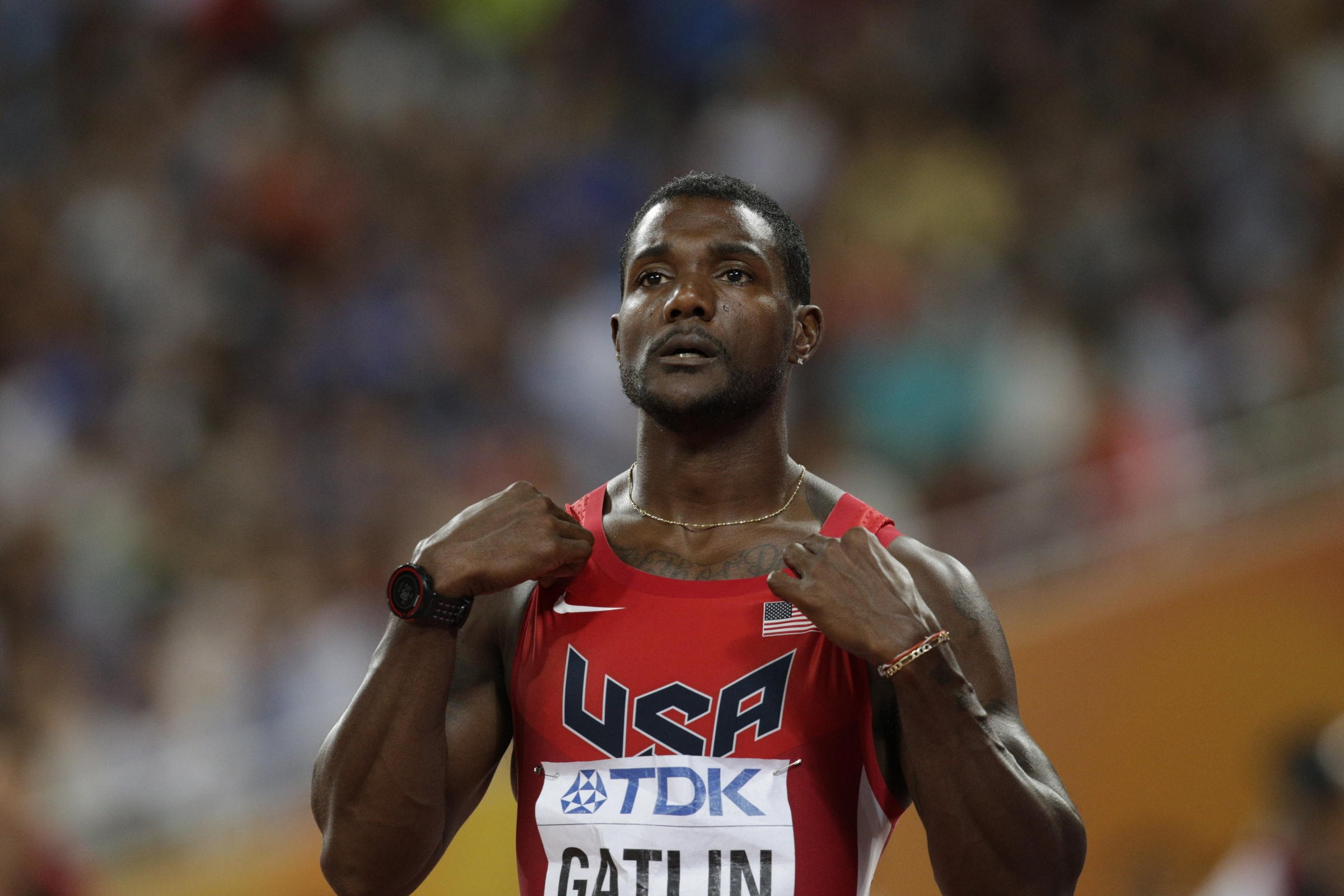 Justin Gatlin (USA) readies himself before the men's 200-meter semifinal.