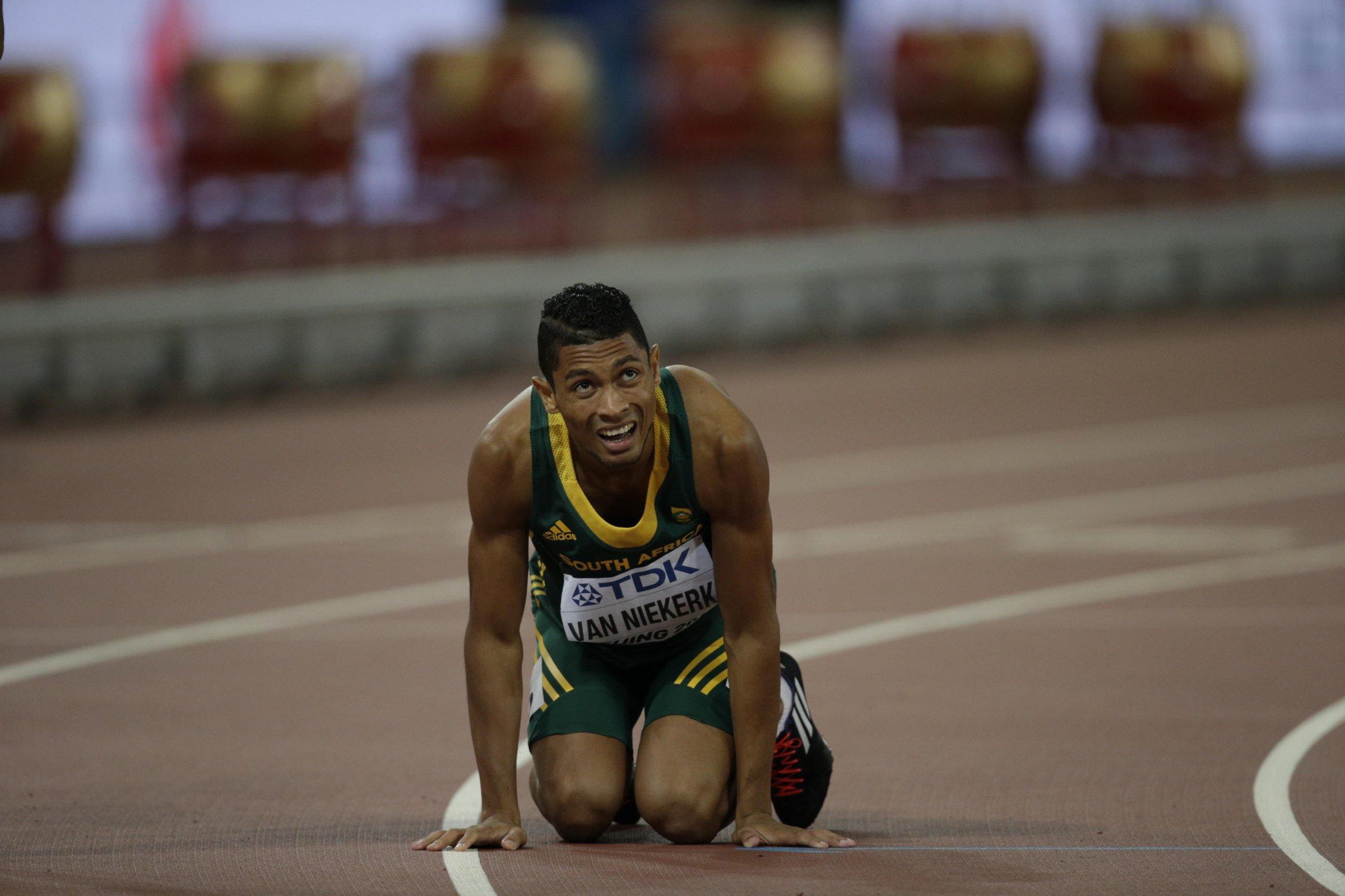 Wayde Van Niekerk (RSA) sits on the ground after running 43.48 seconds for 400-meters and winning South Africa's lone gold medal of the championships.