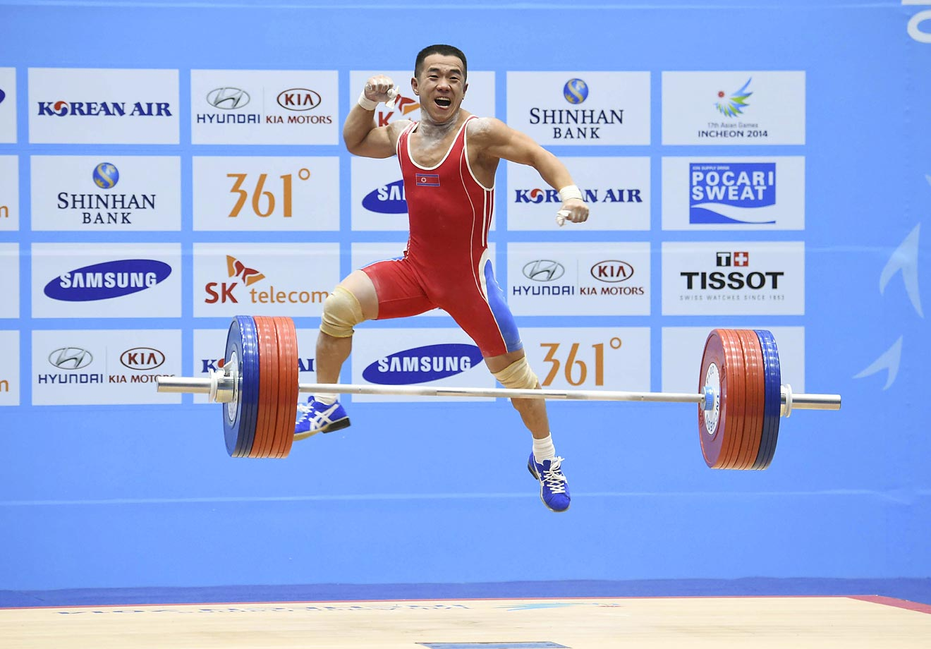 Yan Runzhe of China competes in men's 56kg weightlifting at the Asian Games.