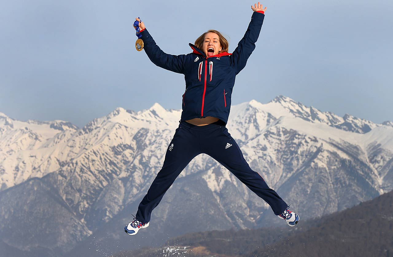 Lizzy Yarnold of Great Britain jumps holding her gold medal after winning the Skelton.