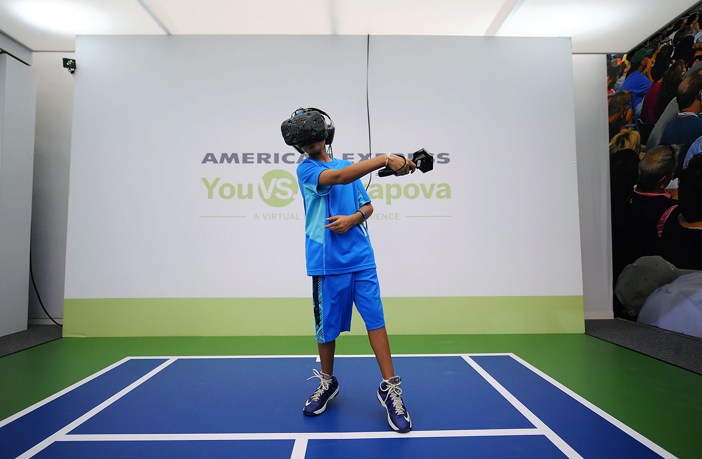 "A young fan participates in the ""You Vs. Sharapova"" Virtual Reality Experience at USTA Billie Jean King National Tennis Center on Aug. 31, 2015 in New York City."