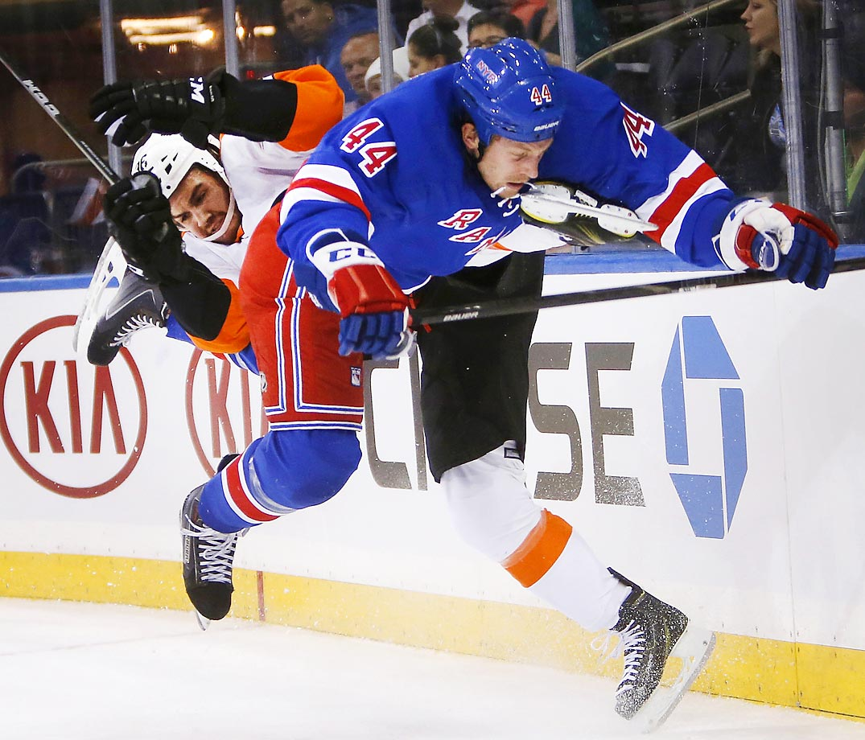 Philadelphia Flyers' Zac Rinaldo and New York Rangers' Matt Hunwick collide during a preseason game.