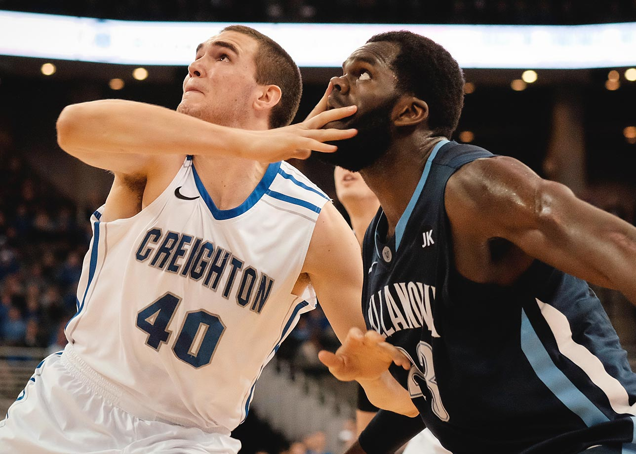 Zach Hanson of the Creighton Bluejays digs in a little too deep while fighting for position with Daniel Ochefu of the Villanova Wildcats.