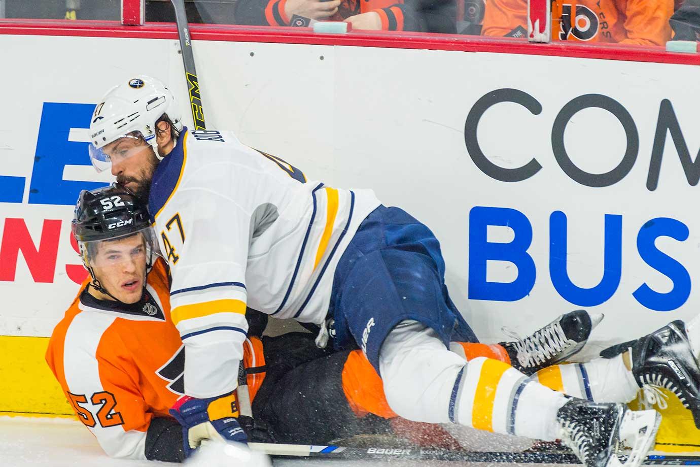 Buffalo Sabres defenseman Zach Bogosian takes down Philadelphia Flyers center Nick Cousins.