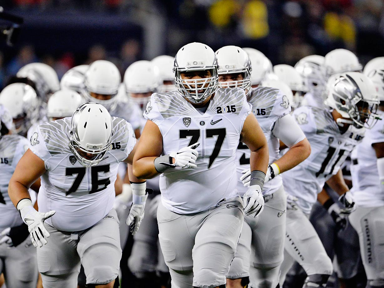 Oregon offensive lineman Hanitelli Louisi leads the Ducks on to the field for the National Championship game.