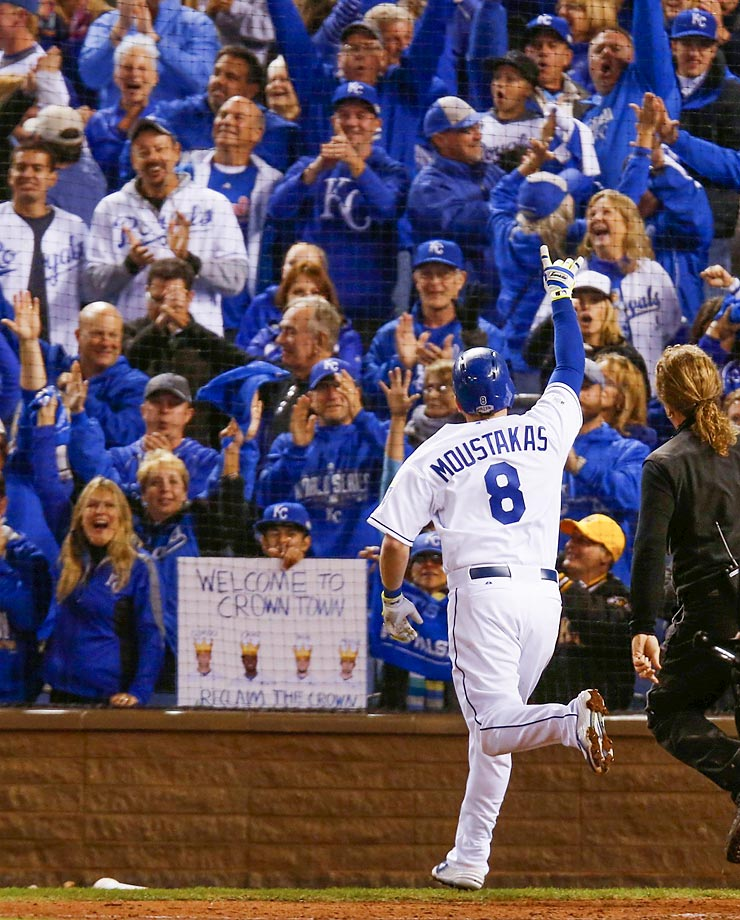 Kansas City Royals third baseman Mike Moustakas celebrates after hitting a home run in the seventh inning.