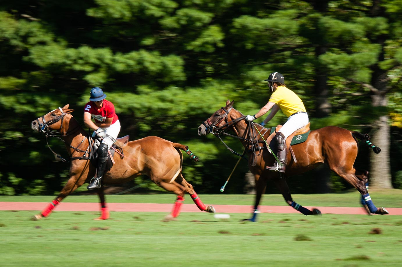 Turkish AIrlines' Joaquin Panelo takes a backshot during the match against McLaren. Polo is a fast game with ponies going as fast as 30 miles per hour.