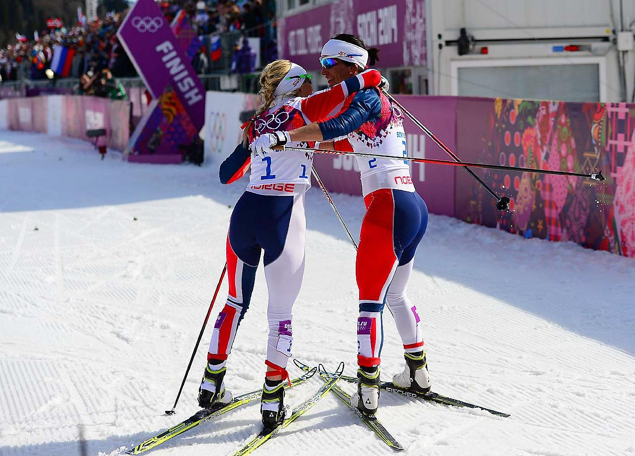 Therese Johaug and Marit Bjoergen of Norway hug after the 30 km Mass Start Free.  It was a good showing for Norway, Bjoergen won the gold and Johaug won the silver.