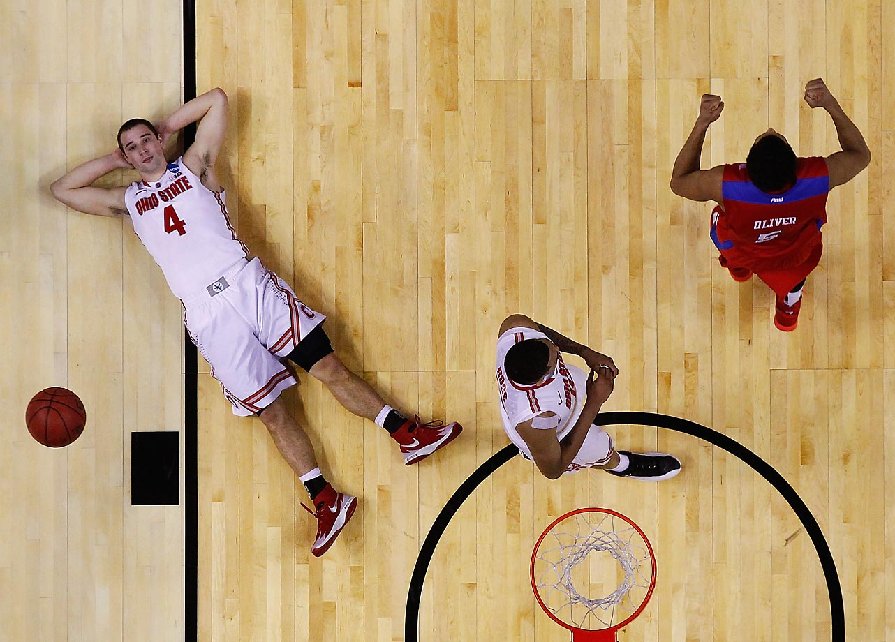 Aaron Craft of the Ohio State Buckeyes reacts after losing to the Dayton Flyers 60-59 in the second round of the 2014 NCAA Men's Basketball Tournament.