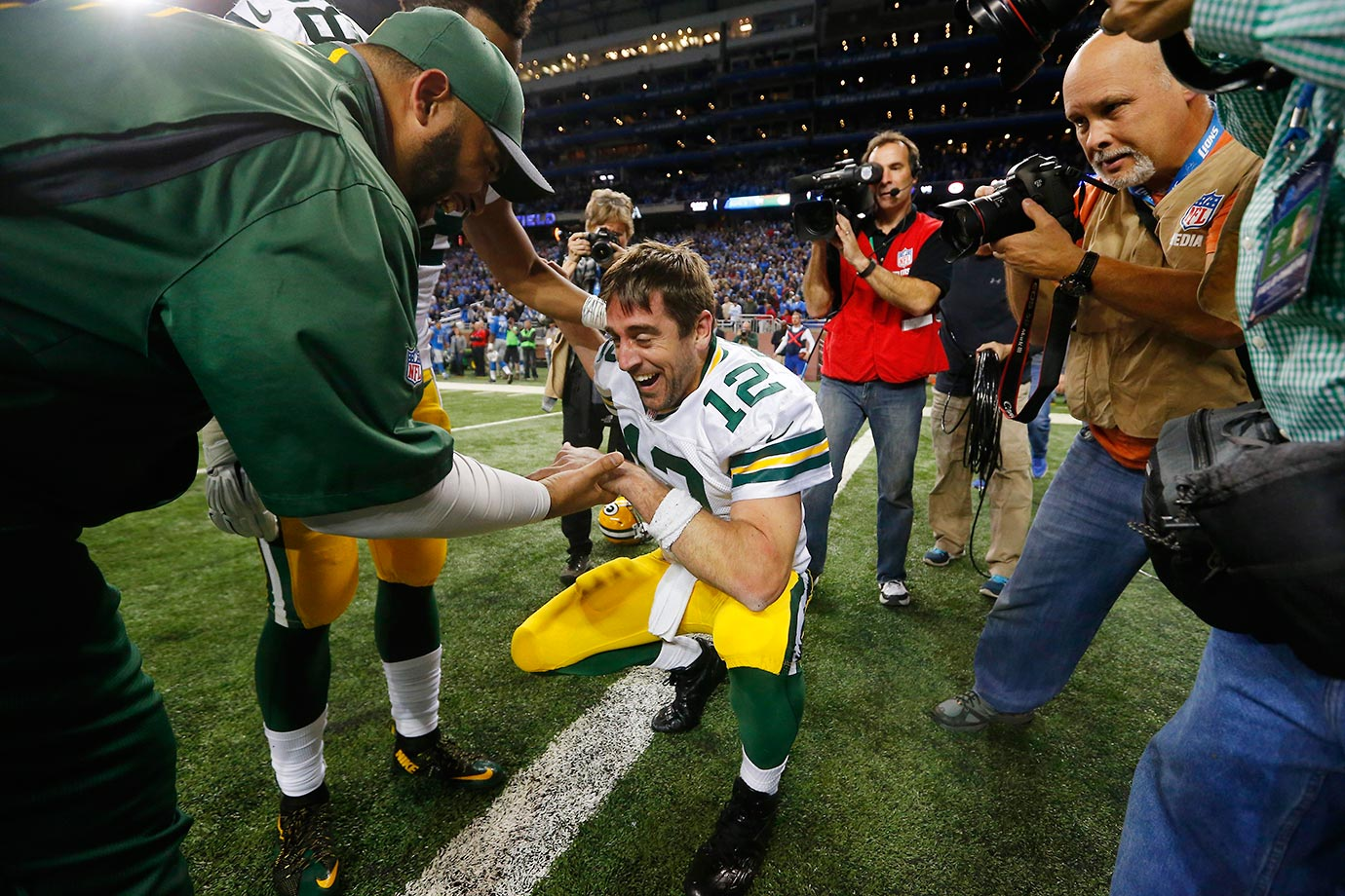Aaron Rodgers of the Packers celebrates after throwing a 61-yard, Hail Mary touchdown pass.
