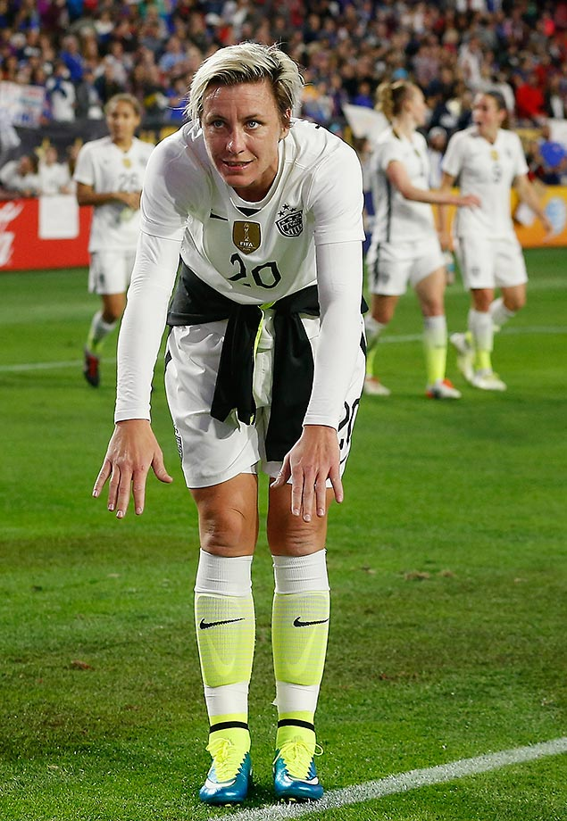 Abby Wambach, who announced her retirement this week, bows to fans as she walks off the field following a match against China in Arizona.
