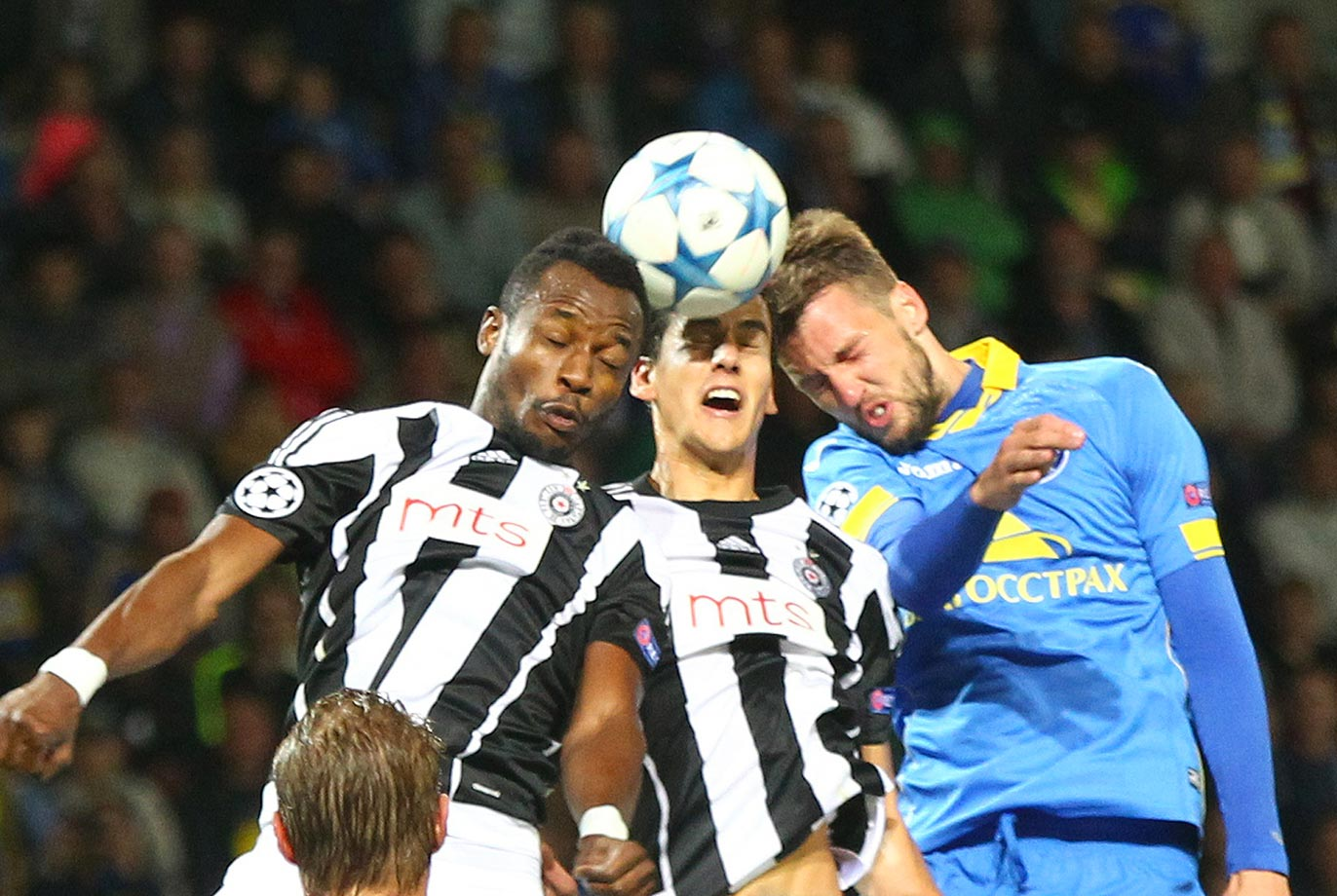 Partizan Belgrade's Abubakar Oumaru, left, and Marko Jevtovic battle Nemanja Milunovic for the ball in Borisov, Belarus.