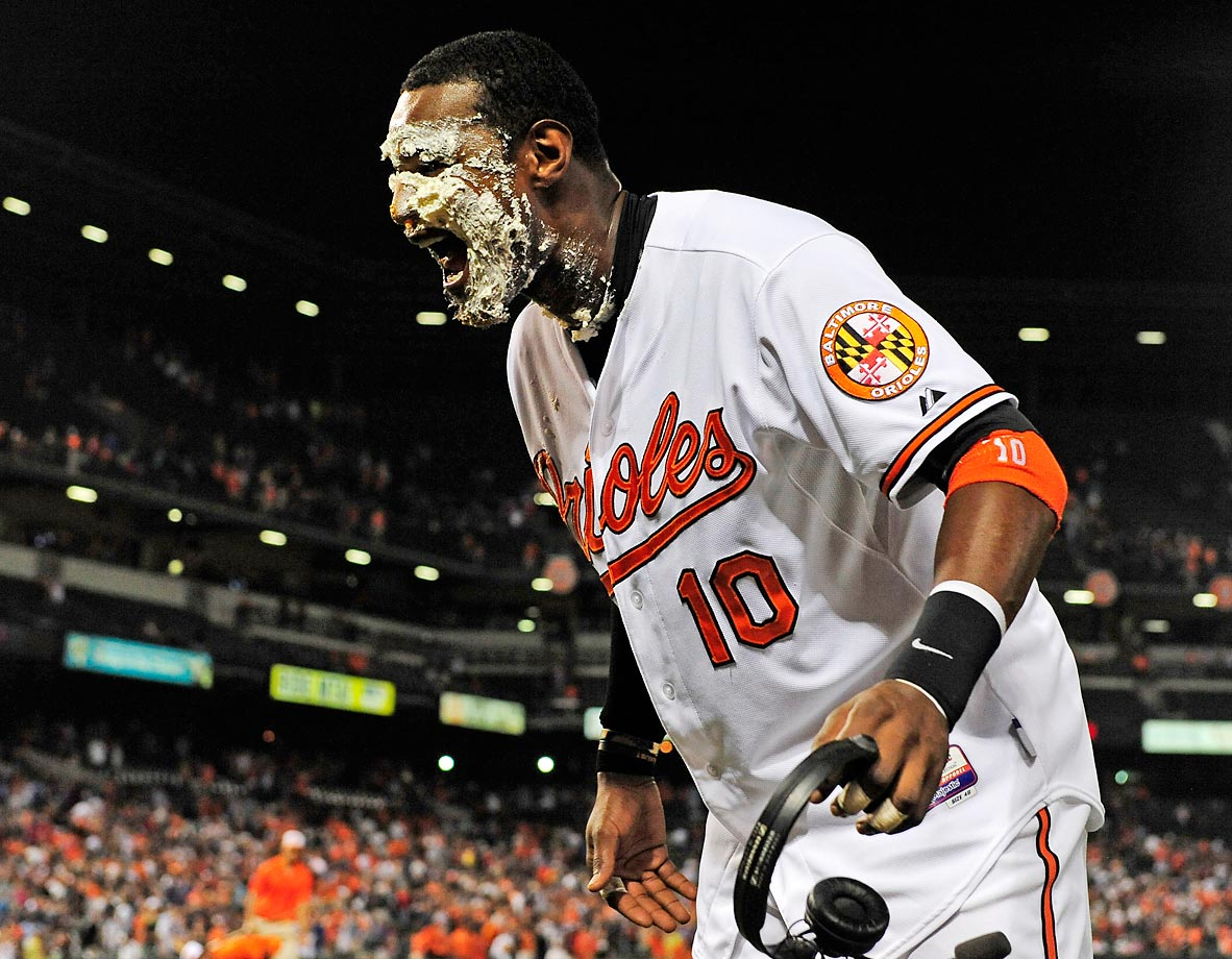Adam Jones gets hit with a pie after the Orioles defeated the Yankees 5-3 at Camden Yards.